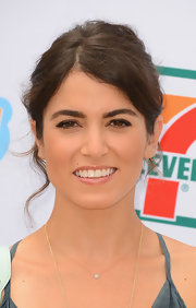 Nikki Reed topped off her boho look with a wavy, messy updo.