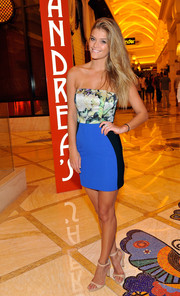 Nina Agdal attended a Las Vegas party wearing a body-con strapless dress that was girly up top and sporty down below.