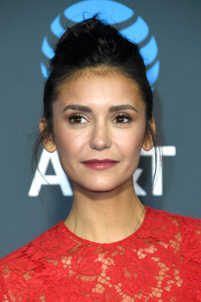 Nina Dobrev Messy Updo [hair,face,hairstyle,eyebrow,forehead,chin,beauty,lip,black hair,bun,arrivals,nina dobrev,critics choice awards,santa monica,california,barker hangar]