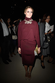 Opting for a monochromatic look, Olivia Palermo paired her turtleneck with a burgundy pencil skirt, also by Nina Ricci.