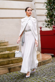 Olivia Culpo polished off her ensemble with a pair of gray pumps.
