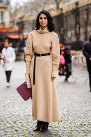 Caroline Issa was cozy and stylish in an ankle-length turtleneck sweater dress at the Nina Ricci Fall 2018 show.
