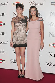 Penelope gracefully walked the red carpet in a blush pink evening gown with silver sequin-embellished shoulders.
