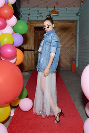 Olivia Culpo contrasted a delicate tulle dress with a tough-looking denim jacket for Nine West's 40th anniversary celebration.