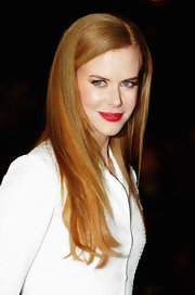 Nicole opted to leave her long tresses down and flowing which she spiced up with a little red lipstick.
