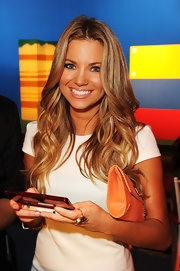 Amber Lancaster wore her long hair in casual waves at the launch of Super Mario 3D Land.