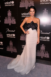 Angie Harmon was a stunner at the UNICEF Snowflake Ball in a strapless black-and-white gown by Angel Sanchez, featuring a ruffled bodice and a floor-grazing hem.