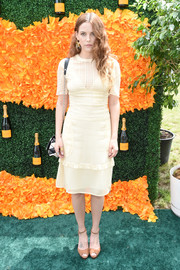 Riley Keough completed her simple ensemble with tan ankle-strap peep-toes by L.K.Bennett.