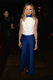 Maria Bello topped off her pants with a simple white sleeveless blouse.
