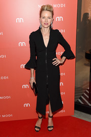 Naomi Watts complemented her dress with a pair of black lace ankle-strap sandals.
