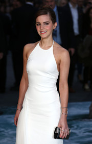 Emma Watson paired a metallic silver Jimmy Choo clutch with a white halter dress for a minimalist-chic look during the London premiere of 'Noah.'