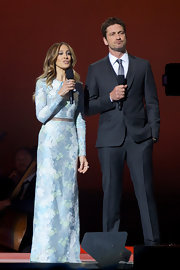 Sarah Jessica Parker hosted the Nobel Peace Prize concert in a beautiful sky blue brocade gown with a sheer inset at the waist.