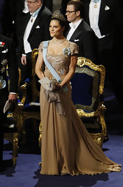 Wearing an empire gown with an intricately beaded bodice and a dramatic train, Crown Princess Victoria looked like a figure right out of a fairy tale.
