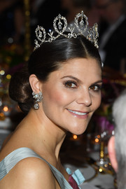 Princess Victoria matched her tiara with an equally gorgeous pair of dangling diamond earrings.