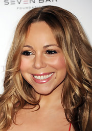Mariah Carey wore a frosty rose shade of lipstick with a vibrant red dress at the Noble Gift Gala.