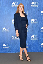 Amy Adams was business-chic in a navy skirt suit by Tom Ford at the Venice Film Festival photocall for 'Nocturnal Animals.'