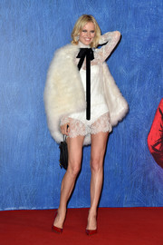 Eva Herzigova glammed up her LWD with a white fur cape.