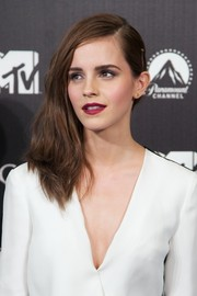 Emma Watson chose a sexy raspberry lip color to finish off her beauty look.