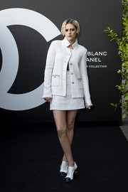 Kristen Stewart looked impeccable in a white tweed skirt suit at the Noir et Blanc de Chanel makeup collection launch.