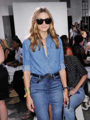 Olivia Palermo accessorized with a superhero-chic gold cuff bracelet.