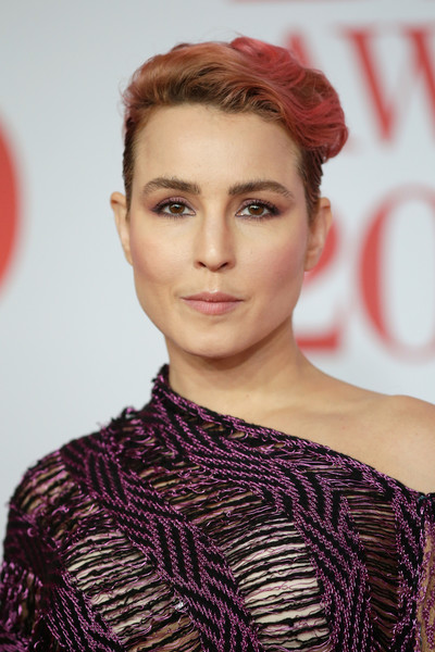 Noomi Rapace Fauxhawk [hair,face,lip,hairstyle,eyebrow,beauty,red,fashion,skin,chin,red carpet arrivals,noomi rapace,brit awards,relation,the o2 arena,england,london]