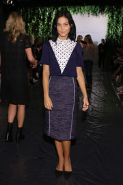 Leigh Lezark attended the Noon By Noor fashion show looking conservative in a high-neck, collared print blouse.