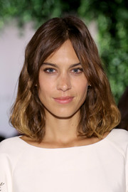 Alexa Chung looked pretty wearing this wavy 'do at the Noon By Noor fashion show.