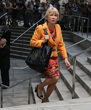 Shirley MacLaine's skirt suit was a burst of color at Nora Ephron's memorial service.