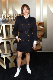 Rashida Jones went military-chic in a black trenchcoat with gold buttons for the Nordstrom Men's NYC store opening.