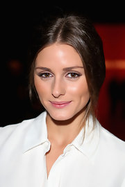 With her glowing, velvety smooth skin, Olivia Palermo looked picture-perfect at the Norisol Ferrari Spring 2013 show in NYC.