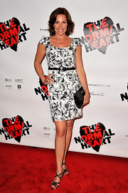 LuAnn topped off her chic monochrome frock with timeless black patent leather accessories.