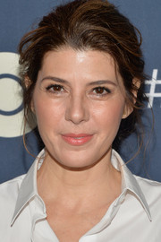 Marisa Tomei attended the premiere of 'The Normal Heart' wearing her hair in a messy bun.