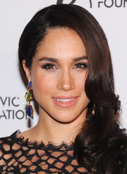 Meghan Markle attended the Novak Djokovic Foundation dinner wearing a pair of colorful gemstone drop earrings.