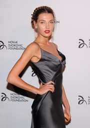 Alina Baikova was a head turner at the Novak Djokovic Foundation dinner with bright red lips and a revealing neckline.