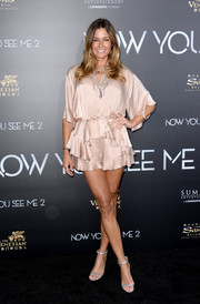 Kelly Bensimon attended the 'Now You See Me 2' premiere wearing a nude silk ruffle blouse and matching shorts.