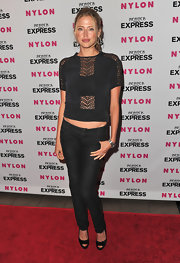 The actress donned a bandeau under a sheer-paneled knit top with skinny jeans and pumps.