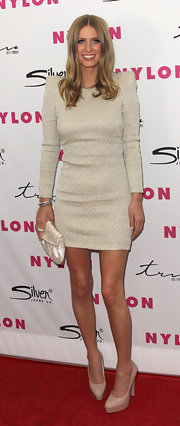 Nicky Hilton paired her ivory bold-shouldered frock with a glam creamy satin envelope clutch.