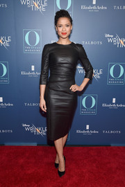 Gugu Mbatha-Raw sheathed her slim figure in a fitted black leather dress by Narciso Rodriguez for the special NYC screening of 'A Wrinkle in Time.'