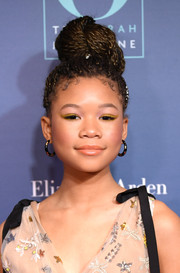 Storm Reid swiped on some yellow eyeshadow for a fun beauty look.