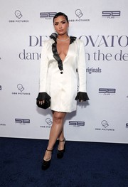 Demi Lovato donned a white Martin Martin blazer dress with black ruffle detailing for the 'Demi Lovato: Dancing with the Devil' premiere.