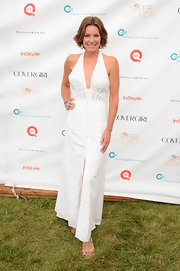 Attending OCRF's 15th Annual Super Saturday in Water Mill, New York, LuAnn de Lesseps looked stylish in this chic summery dress.