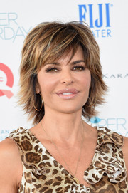 Lisa Rinna looked edgy-glam with her layered razor cut at the 2014 Super Saturday event.
