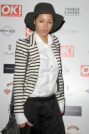 Ana Araujo layered a black-and-white striped blazer over a button-down shirt, with totally chic results, at the OK! Magazine Christmas party.