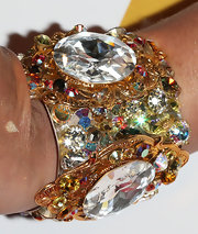 Jessica Sutta picked playful jewelry to match her LBD, like this gemstone cuff bracelet.