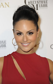 Pia Toscano attended the 'OK!' magazine pre-Oscar party wearing her glossy locks in a voluminous loose bun.