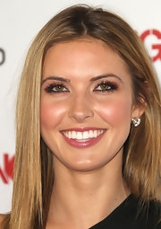 Audrina polished off her radiant look with copper tone eyeshadow at the 'OK' magazine Sexiest Singles party.