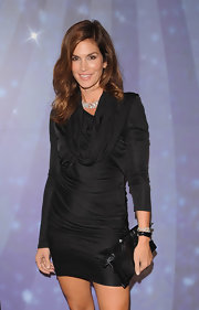 Model Cindy Crawford showed off her brunette tresses which had a slight curl to them at the OMEGA party.