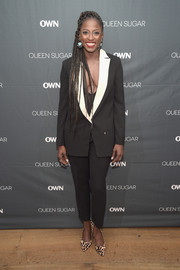 Rutina Wesley styled her suit with a pair of leopard-print pumps.