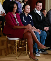 Michelle Obama kept it simple in a fuchsia skirt suit at the National Mentoring Month event.