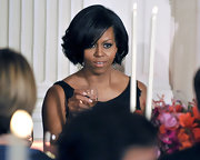 Michelle Obama had a movie star aura about her with this glam high-volume wavy 'do at the Governors Ball.